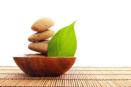 zen stone with leaf and bokeh copyspace showing spa concept photo