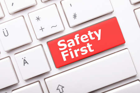 risks button: safety first on computer key showing security concept