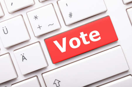chose: vote word on key or keyboard showing election concept