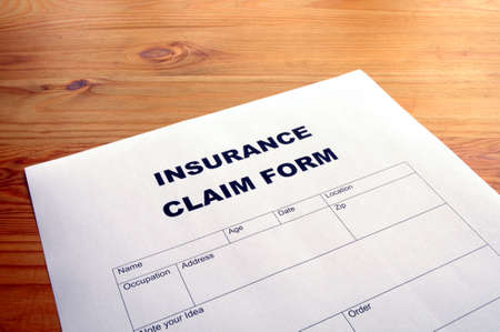 insurance claim for on desk in office showing risk concept Stock Photo - 7724115