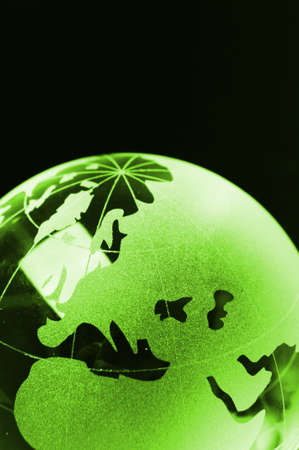 glass globe on black background showing business or environment concept with copyspace photo