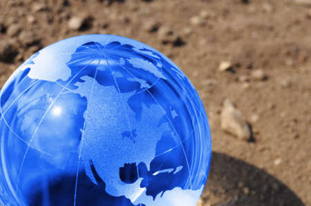 climate change concept with earth planet on dry soil and copyspace Stock Photo - 7724110