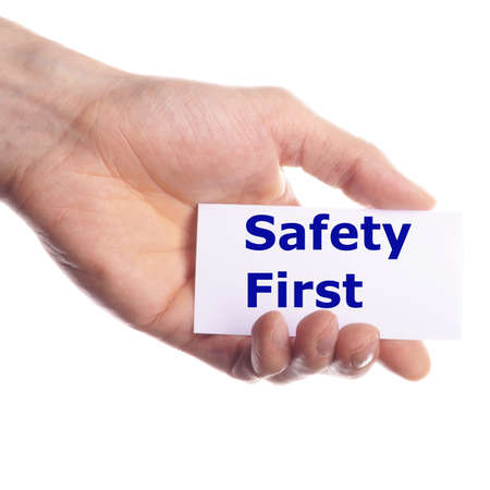 safety first concept with hand word and paper photo
