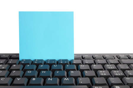 email lists: blank or empty sheet of note paper on keyboard