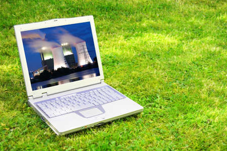 renewabel: power plant in laptop or notebook screen showing energy supply concept
