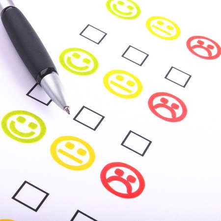 hand pen and checkbox or tickbox with smilie photo