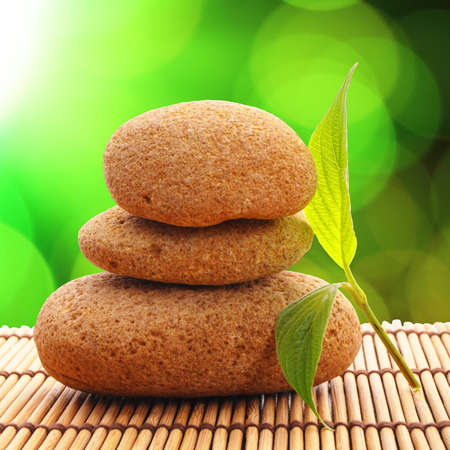 zen or spa concept with stones leaf and copyspace Stock Photo