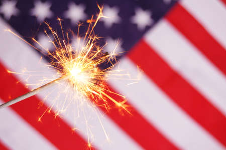 sparkler and usa flag showing 4th of july Stock Photo - 7724088