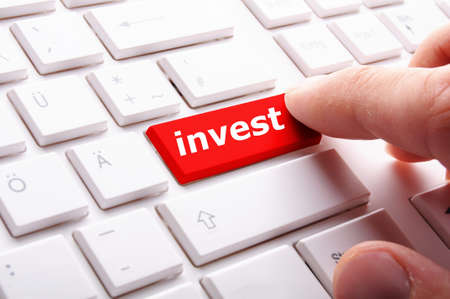 invest or investment key or button in red showing business success photo