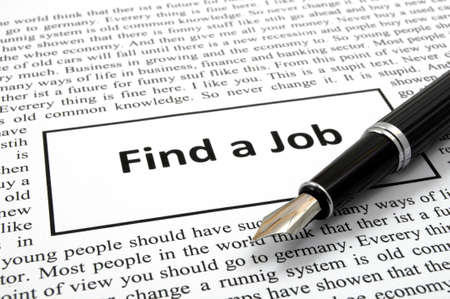 find a job in newspaper showing unemployment concept photo
