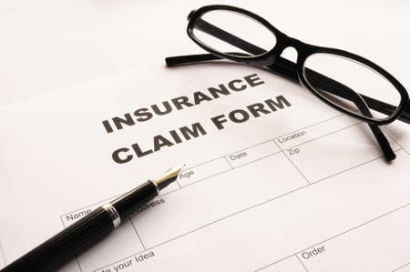 insurance claim for on desk in office showing risk concept Stock Photo - 7763990