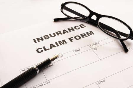 insurer: insurance claim for on desk in office showing risk concept Stock Photo
