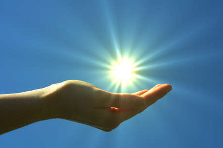 hand sun and blue sky showing hope peace or freedom concept Stock Photo - 7763989