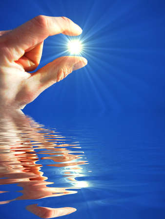 reflaction: hand holding sun and water reflaction with copyspace