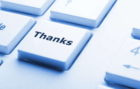 thanks or thank you concept with word on conputer key or button photo