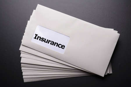 insurance concept with envelope showing risk concept photo