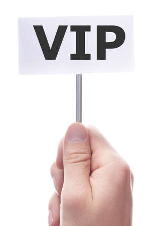 vip or very important person concept with hand and paper Stock Photo - 7794924
