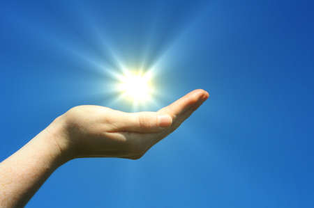 hand sun and blue sky showing hope peace or freedom concept