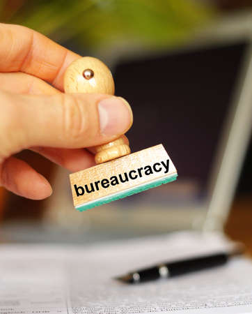 bureaucracy concept with stamp in office and copyspace photo