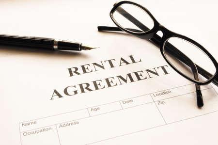 rental: rental agreement form on desktop in business office showing real estate concept