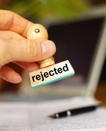 rejection: rejected concept with stamp in business office showing rejection concept Stock Photo