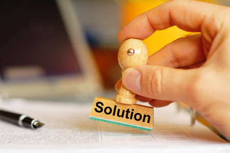 solution stamp showing concept for solving problems in office photo