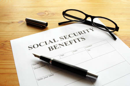 social security: social security benefits form showing financial concept in office Stock Photo