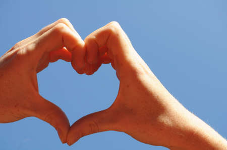 love concept with hand heart and blue sky copyspace Stock Photo - 7880689