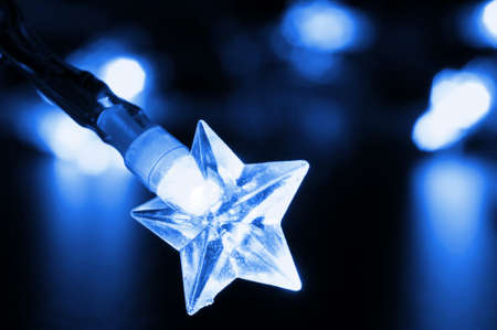 x mas: xmas or christmas holiday star lights with copyspace