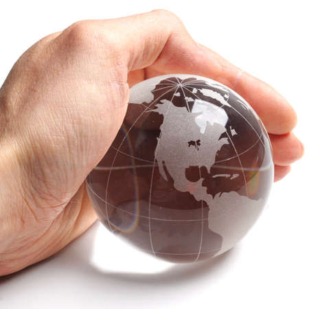 ecology concept with hand and glass globe isolated on white background photo