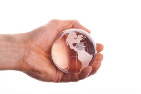 environmental protection or business concept with glass globe in hand isolated on white