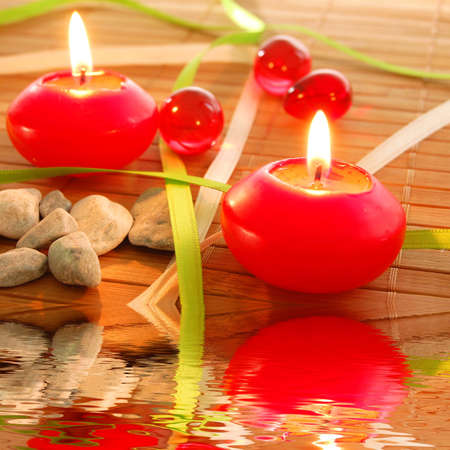 spa candle and water reflection showing zen concept Stock Photo - 7932660