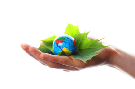 hand holding globe showing ecology or nature concept