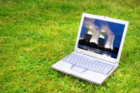 power plant in laptop or notebook screen showing energy supply concept photo