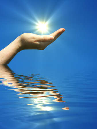 zen water: hand holding sun and water reflaction with copyspace