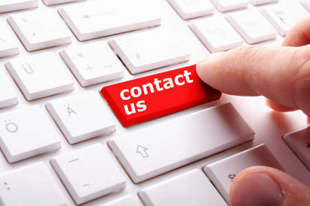 word contact us on red keyboard key photo