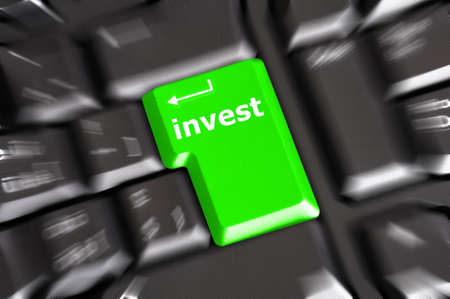 invest key on keyboard showing financial business investment concept photo