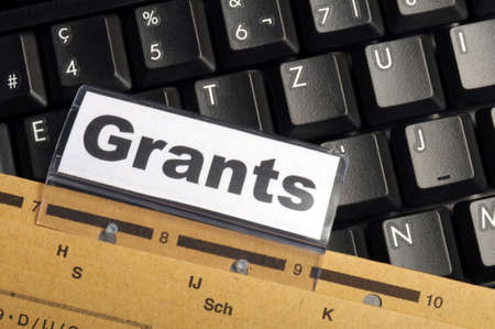 scholarship: grants word on paper folder showing scholarship or higher education concept