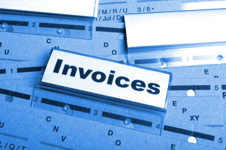 invoice or invoices concept with business folder in office showing paperwork photo