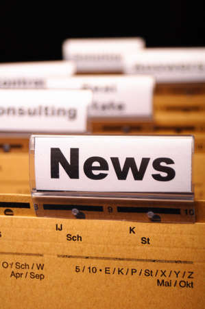 news or newsletter concept with word on folder register in business office Stock Photo - 8067257