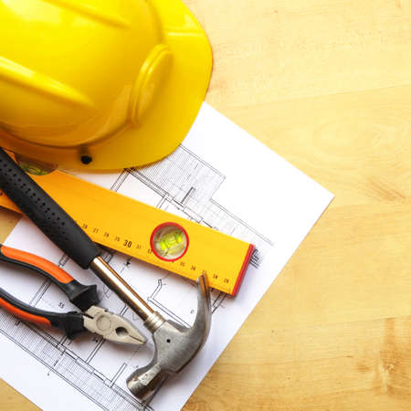 construction concept with hard hat working tools and copyspace photo