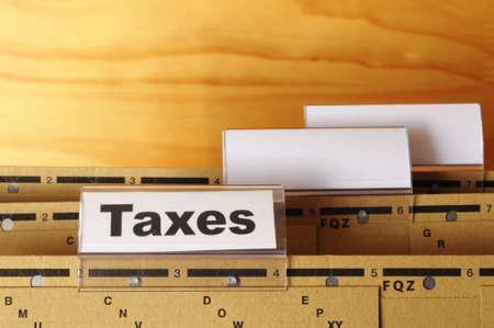tax or taxes concept with word on business folder index Stock Photo - 8119935