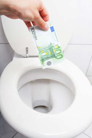 money and toilet showing financial crisis concept photo