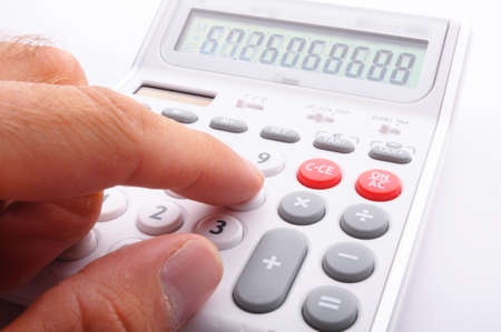 pent: calculator showing business accounting concept in white