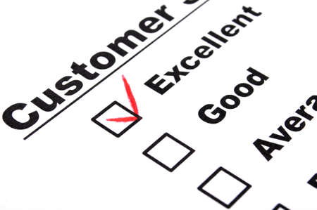 excellent service: excellent or good marketing customer service survey with red pencil and checkbox