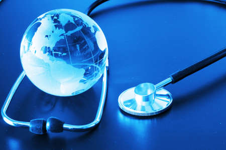 global health: ecology eco environment or global warming concept with glass globe and stethoscope