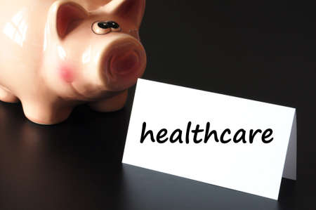 privat: healthcare concept with piggy bank on black background