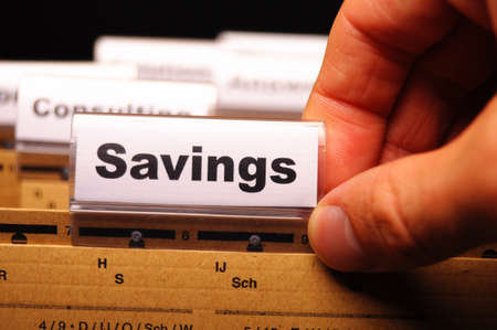 savings word on business folder showing saving money concept Stock Photo