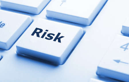risk management concept with word on key showing risky investment photo