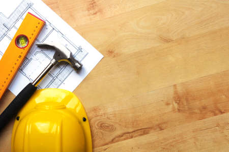 contractor: real estate concept with hard hat blueprints tools and copyspace